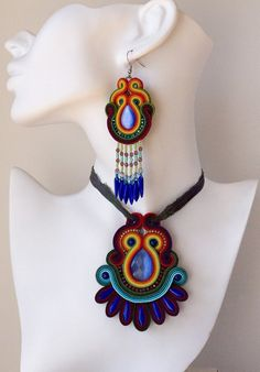A set of soutache jewelry in the colors of the rainbow. Mexican earrings with beaded fringes. Large soutache pendant in autumn colors. - October 05 2019 at Etsy Jewelry, Jewelry Shop, Handmade Jewelry, Jewelry Design, Handmade Necklaces, Soutache Pendant, Soutache Earrings, Gemstone Jewelry, Beaded Jewelry