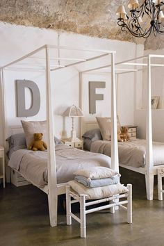 Shared Kids Bedroom with Vintage Letters - Kids Bedroom Ideas. See this kids' bedroom decorated with vintage letters, plus hundreds more kids' bedrooms that don't scrimp on style.