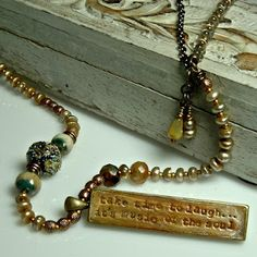 Published in Bead Trends June 2012, this message stick reminds me to get silly once in awhile! Necklace designed by Cherrie Fick of En La Lumiere http://www.designsinthelight.co