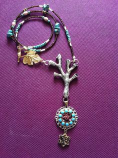 Long gypsy style beaded necklace with turquoise magnesite and tree pendant. $38.00, via Etsy.