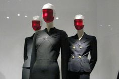 Elsa Schiaparelli Day Suit, summer 1940 Navy wool melton with brass buttons, Elsa Schiaparelli Day Suit, 1938–39 Black wool jersey with brass buttons, Miuccia Prada Ensemble, autumn/winter 1994–95 Black wool knit with metal buttons