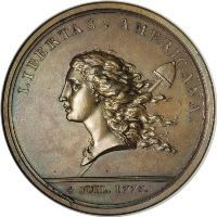 Early type large cents were inspired by a French medal called the Libertas Americana. This historical medal was designed by French medalist Augustin Dupre and was minted in the late 18th Century.