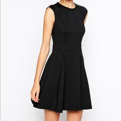 Ted Baker little black dress! Cute flowy back dress with gold color zipper back. Super cute and short but not too short for funerals. Gently worn once. Price firm. Ted Baker Dresses