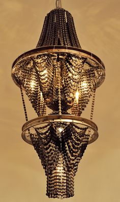 """Carolina Fontoura custom chandelier made from recycled bicycle chains Connect 2 35""""x18""""x18"""" 2008"""