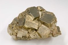 Aggregate of pyrite cubes. Pyrite may shine like gold, but it has nothing like the same value, hence its nickname, 'fool's gold'.  -Mineral Hall- (Photo: Royal Belgian Institute of Natural Sciences, RBINS)