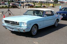 baby blue 65 Mustang and white leather interior