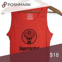 Jagermeister Coral Tank For the party girl in all of us!  Fitted coral Jagermeister tank top.  Size says medium but runs REALLY small.  I usually wear an XXS or XS and its snug on me.  NWOT Boutique Tops Tank Tops