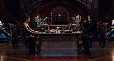 Dinner with Titus - Titus Abrasax's (Douglas Booth) dinner with Jupiter (Mila Kunis) in his chamber as it appears in the final film. - Jupiter Ascending – Official Look Book