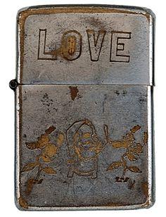 """LOVE""   Vietnam-Era Zippos Engraved With Soldier's Personalities"