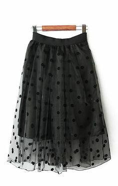 Cute black polka dot mesh skirt.Works with so many things!