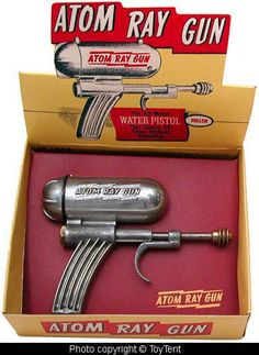 Vintage 1940s metal water pistol ray gun made by Hiller Mfg. Co. USA.  ((anything in the original box has value. Having said that, my friend has covered a small wall with a variety of 1940-50 ray guns...of course destroying the $ value but the intrinsic value of that wall instillation is unbeatable!))