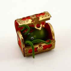 Octopus hiding in treasure chest