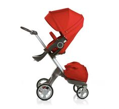 Red baby stroller with baby bag
