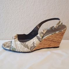 """Etienne Aigner safari print wicker wedge sandals! Only worn once for about an hour, shoes are in near perfect condition! These are the """"Trista"""" in khaki safari print, by Etienne Aigner. A gorgeous slingback sandal with a wicker wedge heel and rope toe detail. The perfect vacation shoe for a tropical getaway! Size 7.5 with a 3.25"""" heel. Straps are adjustable. No trades! Etienne Aigner Shoes Wedges"""