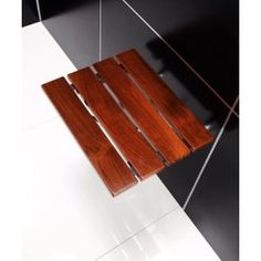 DreamLine Natural Teak Wood Folding Shower Seat in Chrome will add warmth to the feel of your shower space. Designed to mount onto existing surface.