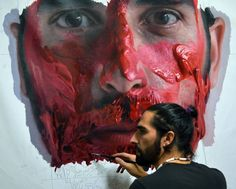 Eloy Morales painting portrait in his art studio #workspace