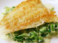 You just put it in a hot pan, and don't move it until it's cooked all the way through. What that means for this cod is one side develops a thick, golden, perfect crust, and the other side is steamed to flaky perfection. I've combined the vegetable and the sauce into one, serving the fish on a bed of simply creamed leeks. Soft and subtle and lovely.