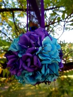 Maybe for the ceremony hanging outside. Make them ahead with fake flowers and different shades of purple