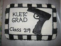 I made this cake for my husband who graduated from the police academy.  It is a 9x13 cake frosted w/ buttercream frosting.  The gun i made out of marshmallow fondant(was my 1st time making that)  The stripes on the sides was suppose to me black and gray every other color but when making the grey i got to much food color in it and didnt have any more white frosting to add to it, so it ended up more black.