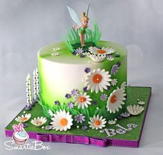 Tinkerbell inspired cake with daisies - SmartieBox Cake Studio