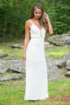 You're going to love this gorgeous cream maxi! Featuring a gorgeous cream fabric, this maxi is so elegant! We also adore the golden eyelets and accents on the bodice and straps - they will simply shine on a summer night!