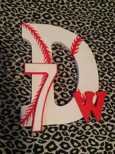 "Made this for my boyfriend in honor of his senior night for baseball. I bought the wooden letters and numbers from Michael's Arts and Crafts Store and painted the baseball seams with red acrylic paint, the ""w"" I painted red and I outlined the ""7"" in red too Baseball boyfriend gift"
