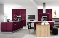 Eggplant purple kitchen cabinets. Stainless steel. Modern. Contemporary. Trendy. Colorful. Inexpensive kitchen makeover. DIY.