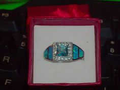 LOOK!!!!! A STERLING SILVER GENUINE BLUE AND WHITE TOPAZ AND AUSTRALIAN BLUE FIRE OPAL RING SIZE 6