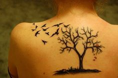 Love the tree design .. a couple ravens . and a red heart dangling from one of their beaks .. my next tattoo :)