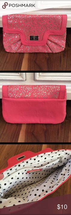 Coral Clutch Worn once, in great condition. Picture makes it look more pink then it is. Call It Spring Bags Clutches & Wristlets