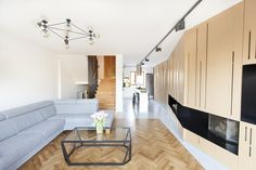 Timber Terrace - a living room with light furnishings and wood paneling, featured on NONAGON.style