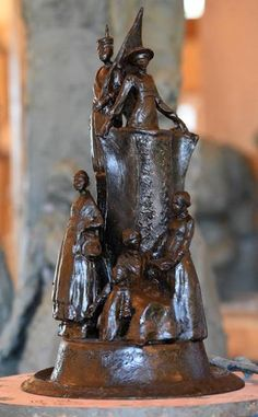 A bronze sculpture c...