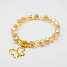 This bracelet can be worn for any occasion but will benefit Children's Cancer through the charity CureSearch. http://www.curesearchgold.org/butterflywarriors Handmade with 6mm and 8mm champagne facete