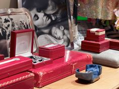 Cartier boxes flanked by photos of Taylor and Burton.