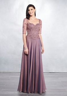 Floor length iridescent chiffon circular A-line dress with sheer elbow-length beaded tulle sleeves, a sweetheart neckline, and a scalloped dropped waistline. Plus Size Formal, Mother Of The Bride Gown, Mother Of Groom Dresses, Bridal Dresses, Flower Girl Dresses, Pink Dresses, Formal Dresses, Mary's Bridal, Glamour