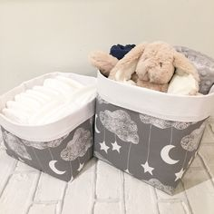 Gorgeous Lullaby storage baskets. Grey and white fabric featuring stars, moons and clouds. Perfect nursery decor.