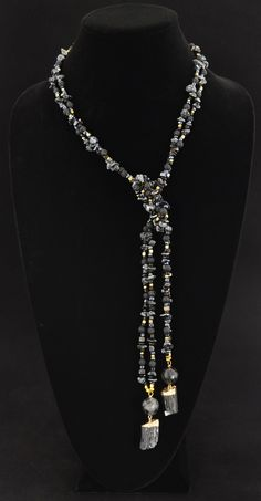 """Black Velvet"": This elegant lariat design features two strands of obsidian stones, lava stones, free-form hematite, black onyx, faceted golden pyrite, vermeil beads, and rutilated quartz with two black velvet tourmaline stone pendants, all set in vermeil. ""Black Velvet"" can be worn in numerous ways to suit a variety of necklines."