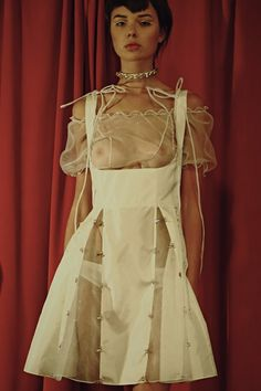 A sheer Lolita dress from emerging duo Ammerman Schlösberg for SS15. More images here: http://www.dazeddigital.com/fashion/article/21626/1/ammerman-schlosberg-ss15