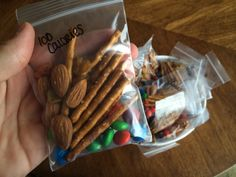 Little homemade 100 calorie snack packs: 10 pretzel sticks, 10 plain M&Ms, 5 almonds, and 5 golden raisins = 100 calories. A quick healthy snack that's salty and sweet. The little bags are cheap, from Hobby Lobby. Great way to keep portions limited when snacking, for adults and kids! :) -Mandy Ashcraft