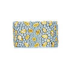 Pflasterstein-Armband aus Platin und Gold mit gelben und weißen Diamanten.