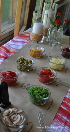 Make Your Own Pizza Party -beautiful make your own pizza party, where guests create their own by choosing their toppings.  Beautiful decorating ideas too.