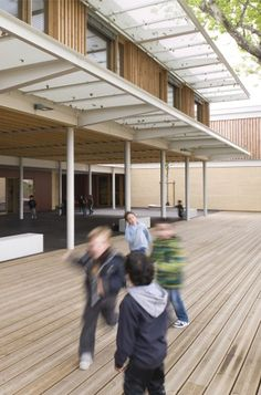 Jean Carriere Nursery School in Nimes, France.    The cross-shaped plan allows simple, clearly visible operation. The circulation areas are not just ordinary corridors. They are treated like habitable areas, widely open to the landscape, with views in all four directions. The partitions between the classrooms and the circulation areas are partly glazed, to allow through views from one external wall to the other.  The internal atmosphere is similar to an open-plan office area ...