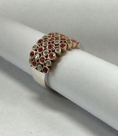 A unique design 14K white gold with 16 diamonds and 16 pink stones. #williamsjewellerstoronto