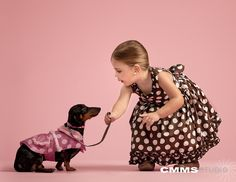 Dachshund photos with kids...@Holly Tuttle Pugh needs to work on this
