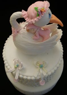 Mommy Stork Cake Topper These pretty Mommy Stork would make a great addition to that special occasion a great cake topper and a excellent piece to place as topper for center pieces, and other baby sho