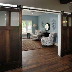 I like the sliding door idea. More interesting than a regular door, better than a pocket door.
