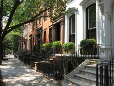 Brownstones <3 with a home like that, I wouldn't mind being the stoop kid, never leaving my front steps