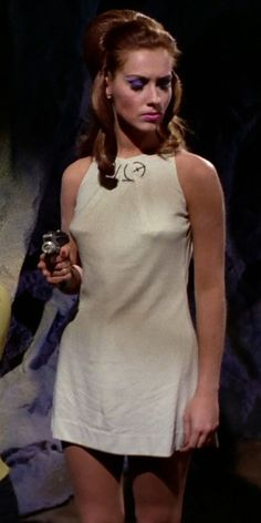"""TOS: """"The Cloud Minders"""": Vanna's third outfit is her prison uniform. On its own, it's the opposite of spectacular, but it looks great when worn by her. Star Trek Characters, Star Trek Original, Originals Cast, Star Trek Tos, Looks Great, High Neck Dress, Clouds, Actresses, Stars"""