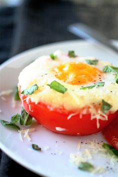 1. Preheat the oven to 425 degrees.  2. Slice off the tops of each tomato and hole out the centre    3. Place the tomatoes in an oven-proof baking dish, with the tops.   4.  Place tablespoons of  cheddar in the bottom of each  5. Break an egg into each tomato  6.  Bake the eggs for 20 minutes  7. Remove and let sit for 2 minutes  8. Sprinkle with S&P