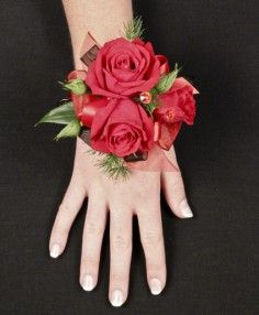 putting on the ritz red rose corsage